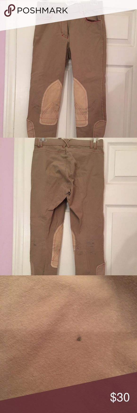 Tan Breeches Awesome tan breeches! Brand is unknown but I paid at least $100 for these. Only worn a couple times. There is a small black spot on the butt (last pic). There are some black marks below the knee from my tall boots, if you wear tall boots or half chaps you can't notice them. Red and white trim detail. Some spots have a few trim stitchings missing, but not noticeable and very easy to fix if you'd like.  Size 28, but runs a little on the smaller side. Pants Skinny