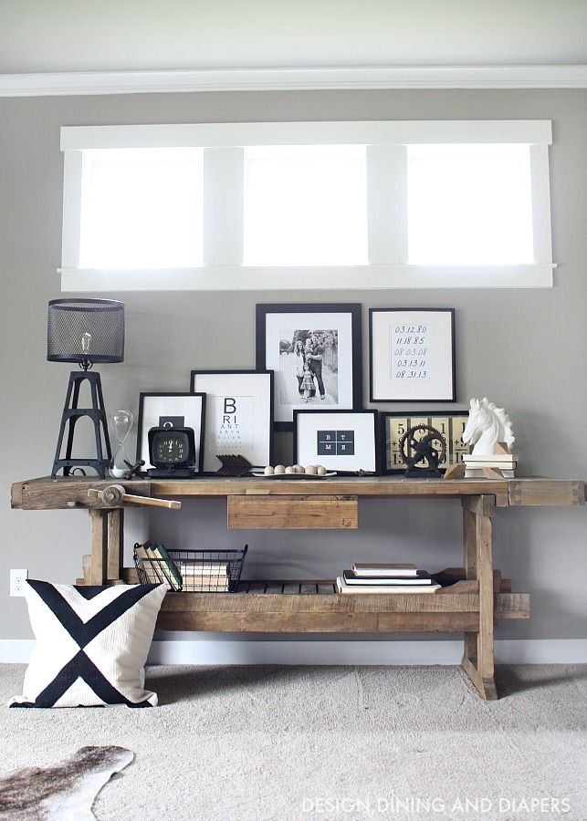 Modern Rustic Console Display. Love the mix of sleek modern black and white with the rustic table.