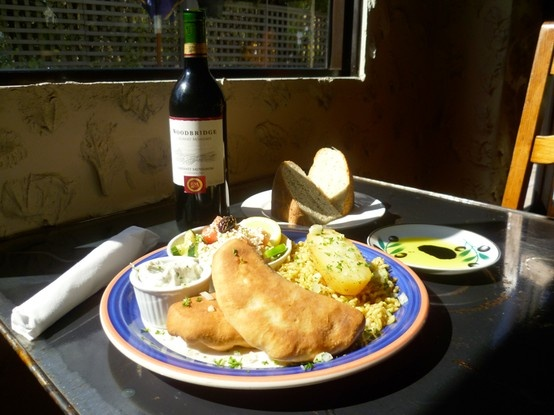 Piroskia! A Greek perogy dish with home made dough and stuffed with ground beef & lamb, feta & caramelized onions.