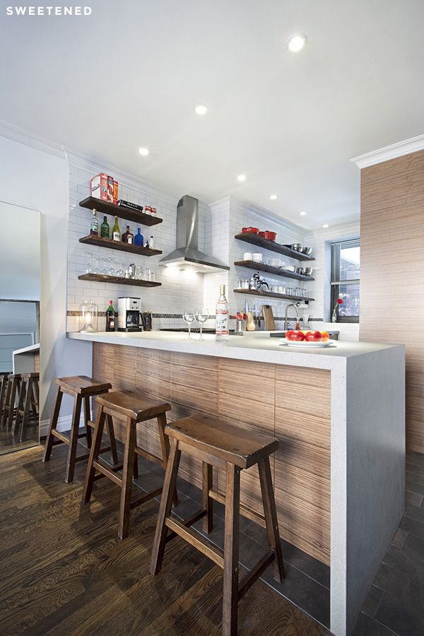 Industrial modern kitchen balanced by raw and unfinished accents with natural and synthetic wood to maintain a measure of warmth and masculinity in Hell's Kitchen.