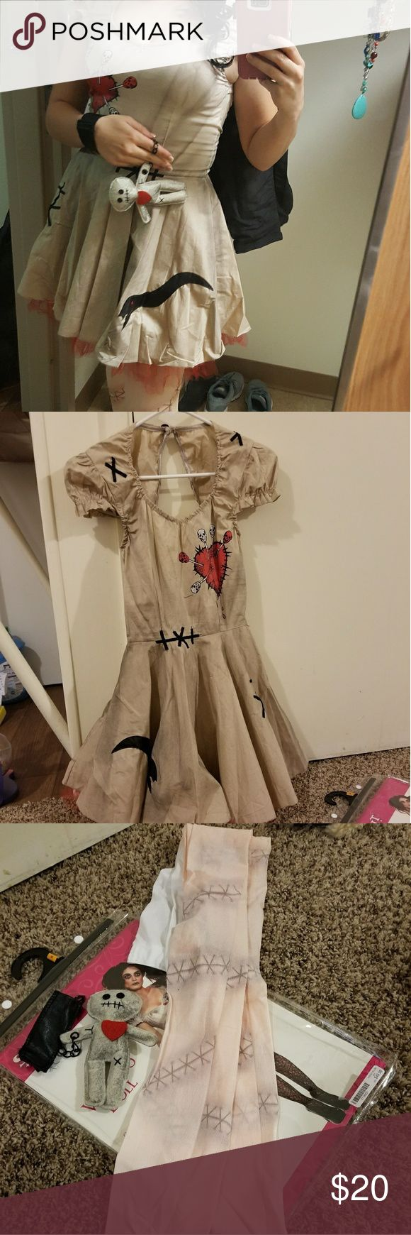 Voodoo Doll costume Only worn once, it's in perfect condition.  The original costume was only the dress and the little voodoo doll but I added in the nylons that I wore with the costume since they go so well with the costume. The original price for the costume was 50$ and the stitched tights were another 15$. Spirit Other