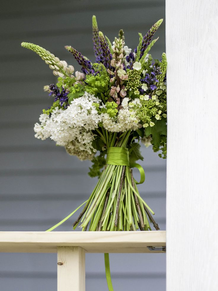 Wild purple and rose lupins / white lilac / white briar / arrowwood flowers and alchimilla bouquet / early summer
