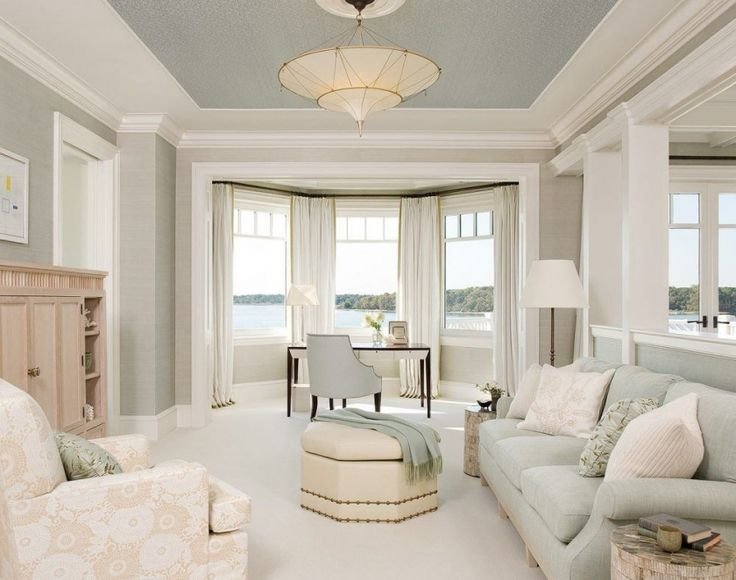 The deeper tone in the ceiling gives the illusion of a higher ceiling. Love the subtle color scheme & the light fixture!