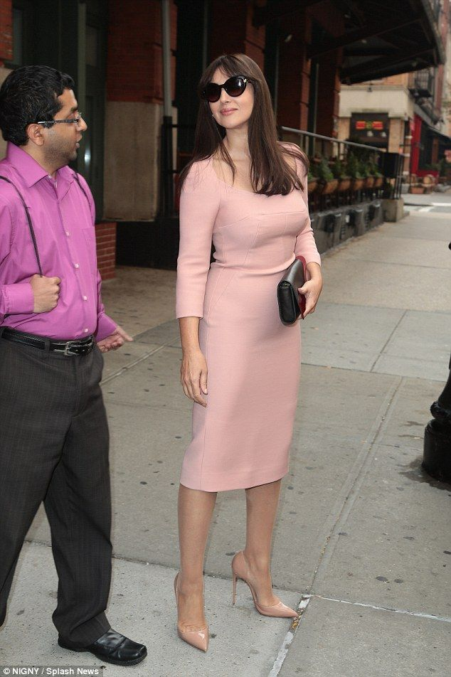 Pink to make James Bond wink: Monica Bellucci put on a sartorially stunning display as the...