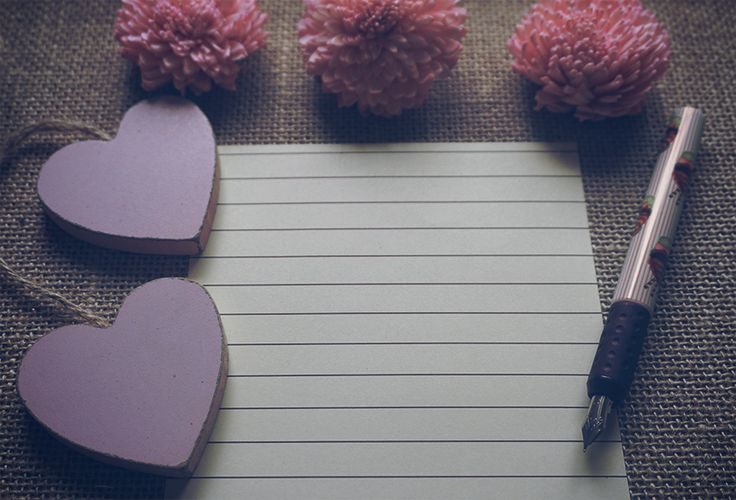 Free stock photo for mockup with cute decoration of pink dry flowers, wooden pink hearts, fountain pen on sackcloth textured rustic background with negative space for write message, add any text, add a photo or your own design.