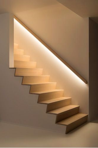 LED lighting hidden beneath a handrail in a stairwell adds a guiding light and attractive feature to this area of the home. Photo credit- deco trap.be