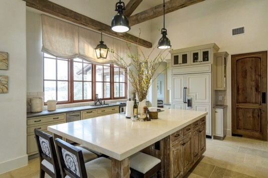 Beautiful contrast between the island granite & cabinets and the rest of the kitchen.