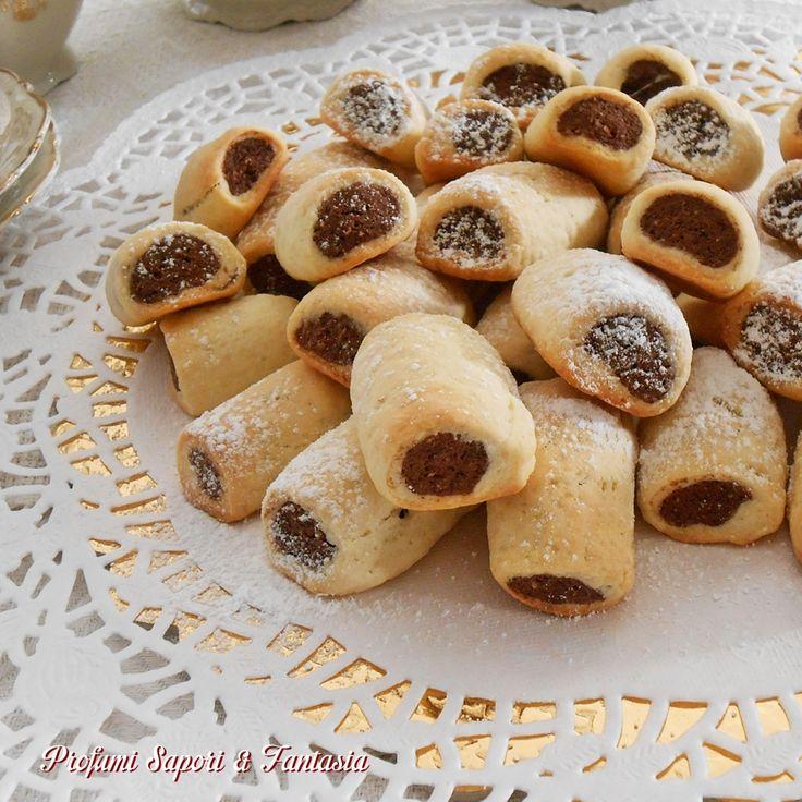 I biscottini panna e cacao arrotolati sono ottimi dalla colazione alla merenda. Genuini creati con prodotti sceltidi qualità piaceranno a tuttiin famiglia.
