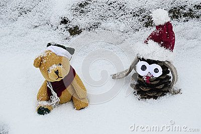 Closeup photo of a Cone toy and a cute teddy bear in the snow