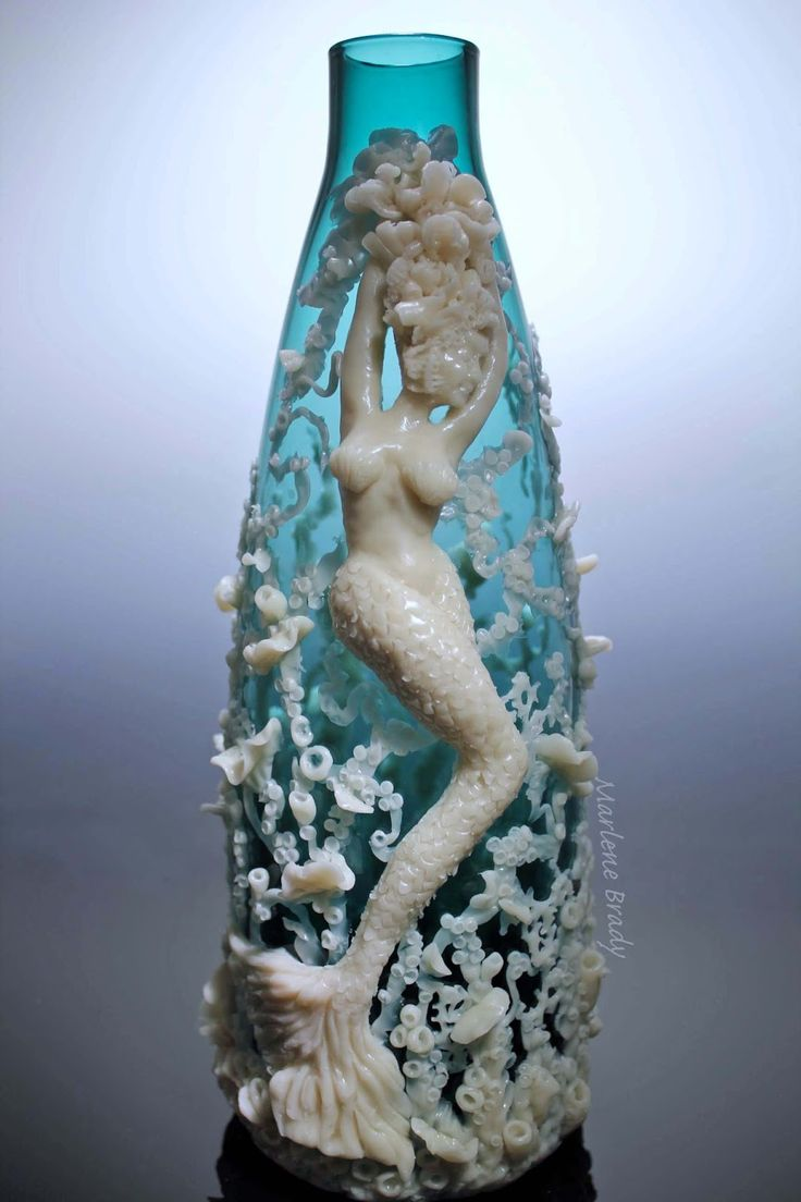 Marlene Brady:  Mermaid sculpture   using translucent polymer clay.