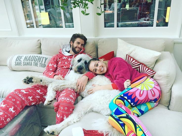 Miley Cyrus and Liam Hemsworth cozy up together over the holidays Miley Cyrus and Liam Hemsworth weren't shy about flaunting their love over the holidays. #TheVoice #MileyCyrus #ChrisHemsworth #LiamHemsworth #TheHungerGames @TheVoice