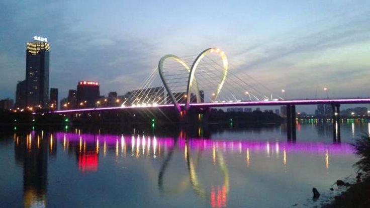 Sanhao St. Bridge over Hunhe River at dusk on in Shenyang, China
