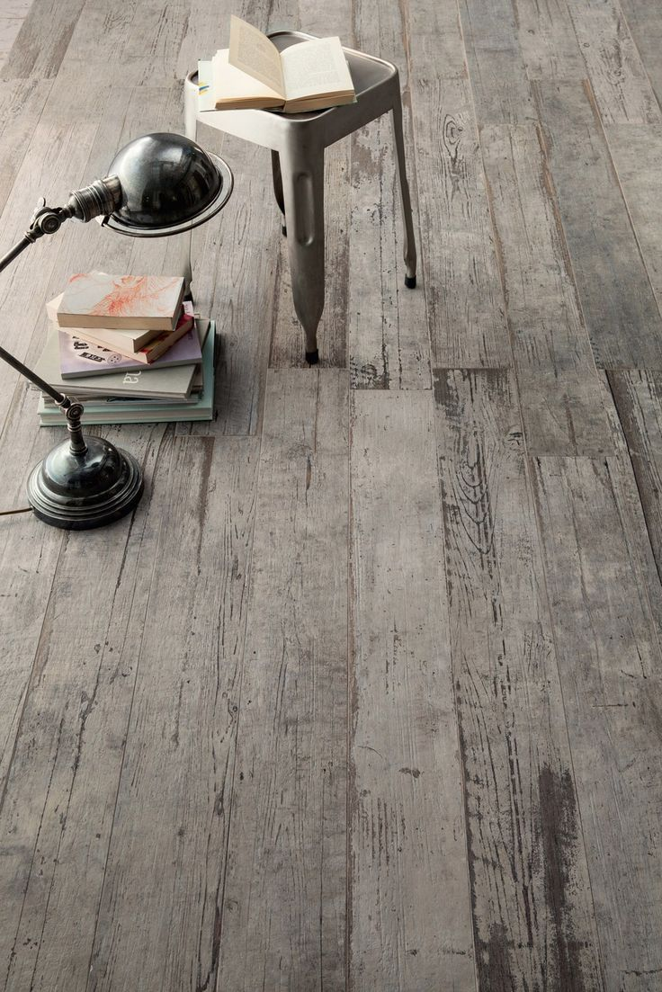 This incredible distressed wood floor has a secret. It's not really wood. It's wood looking tile. Introducing Blendart - the new porcelain tile collection