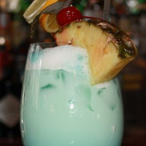Swimming Pool Cocktail With Absolut Vodka, Malibu Caribbean Rum, Pineapple Juice, Heavy Cream, Blue Curaçao