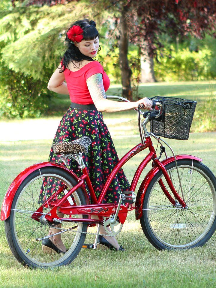 """$49.00  The Cherry Swing Skirt is designed by Rockabetty and manufactured right here in Winnipeg!     100% cotton back-zip skirt with a 2"""" waistband that hugs *just right*.     Note: 2XL and 3XL are the same great style, but with a pull-on elasticized waistband rather than zip back.    The 25"""" length (from base of waistband) is the Perfect length for pairing with Crinolines!     A full, but not too full skirt that fits all body types, in prints that are To-Die-For!!"""