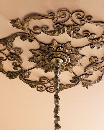 """Ceiling Medallion at Horchow. Our acanthus-leaf medallion adds a design element to the ceiling. It's made of hand-painted iron and tole with a 3""""Dia. hole for chandelier chain. 37""""Dia. x 1""""D."""