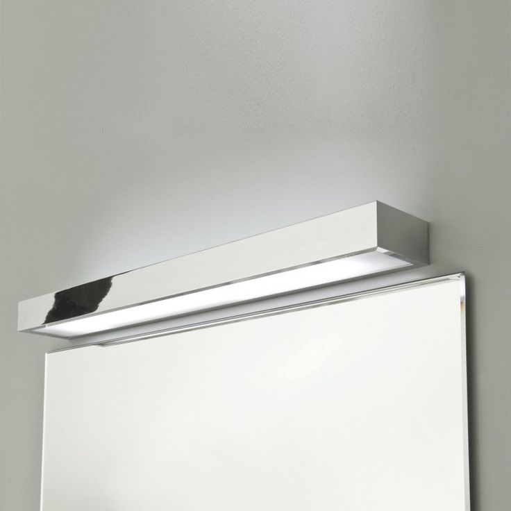 Tallin 1200 bathroom wall-light. Polished chrome finish, white glass diffuser. Uses a 54w T5 High Output fluorescent lamp. IP44 rated, suitable for bathroom zones 2 and 3. Class 2, double insulated. Includes integral electronic ballast.