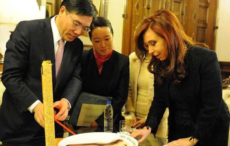 Argentina's president Cristina Kirchner with executives of ICBC in Buenos Aires.  ICBC's expanding presence in the city is indicative of China's growing role in lending to Latin America, surpassing the World Bank.