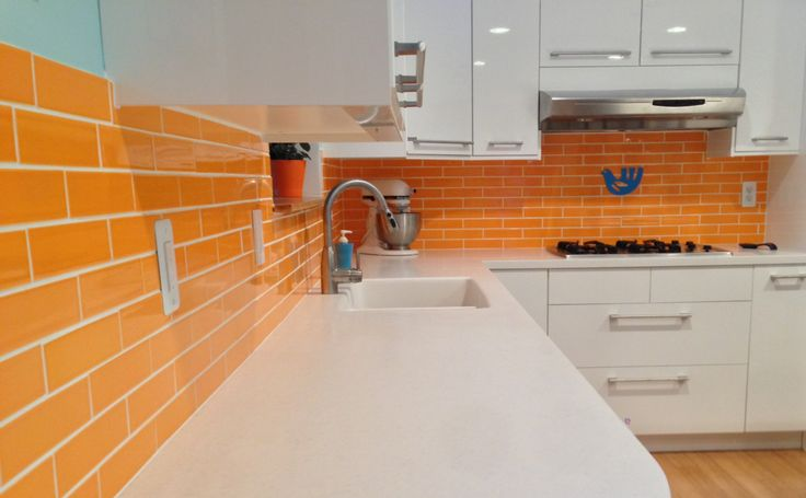 Our Clayhaus for Modwalls American made 2x8 ceramic subway  tile in our signature Zest orange makes a happy backsplash. www.modwalls.com