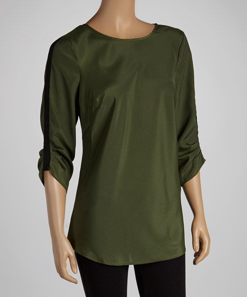 Lovely and lightweight, this breezy piece is finished with an on-trend olive hue, while contrasting panels line the sleeves for added detail and style.Measurements (size S): 28'' long from high point of shoulder to hem100% polyesterMachine wash; tumble dryImported