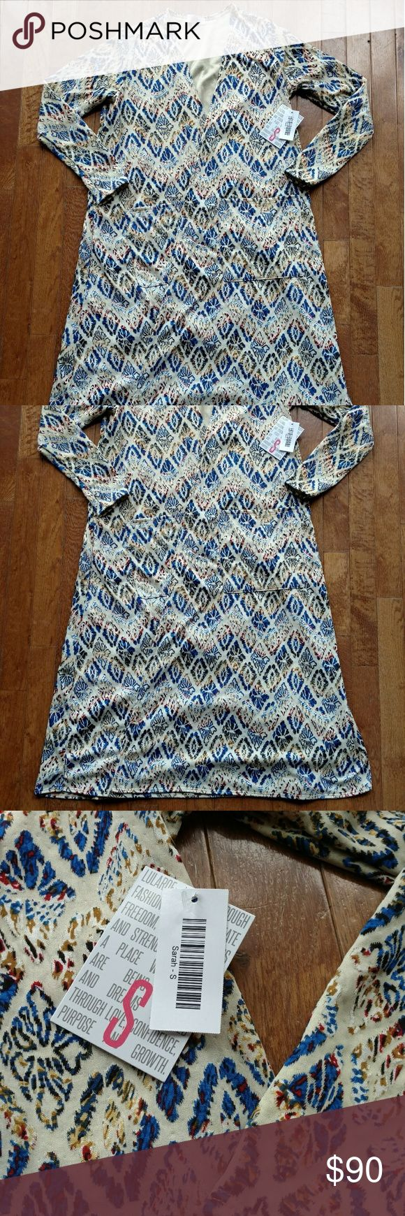 Simply Stunning Sarah Duster This is just gorgeous! Cream background with overlayed pattern of blue, tan, black and maroon. Head Turner for sure! Small amount of stretch. Completely brand NWT. Hard to find item. Smoke free home. LuLaRoe Tops