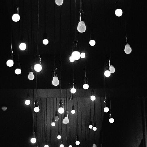 A few exposed bulbs, or half broken fixtures, would be a good touch.