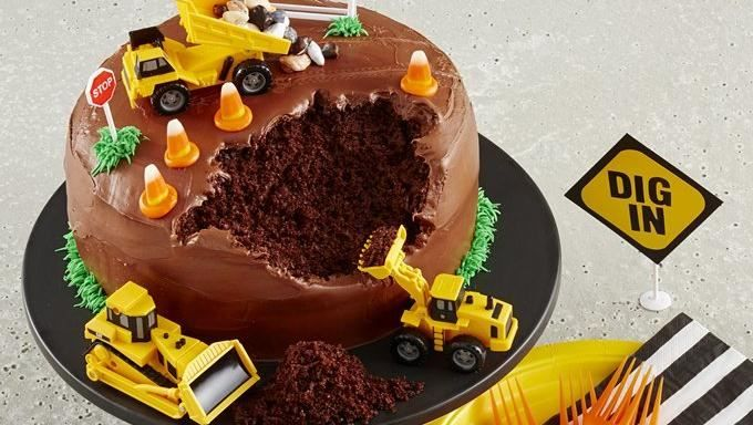 This clever birthday cake is easy to make with Betty Crocker cake mix, ready-made frosting and a few toy trucks. There's literally no way to mess it up!