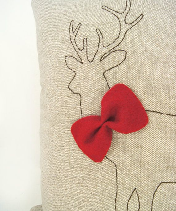 Christmas pillow cover,  - Brown deer silhouette with red felt bowtie on natural fabric, via Etsy.