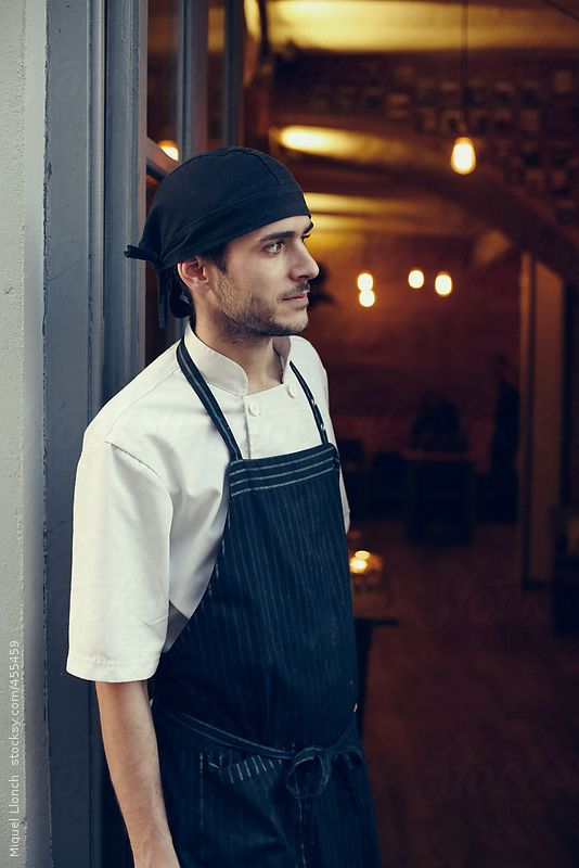 Portrait of a cook at the front door of the restaurant by Miquel Llonch