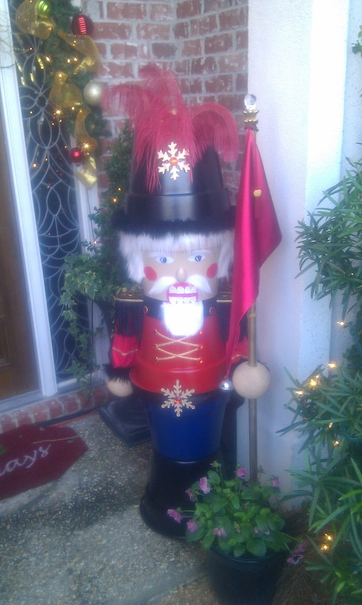 5 ft tall toy soldiers I made for Christmas decorations beside my front door out of plastic flower pots.