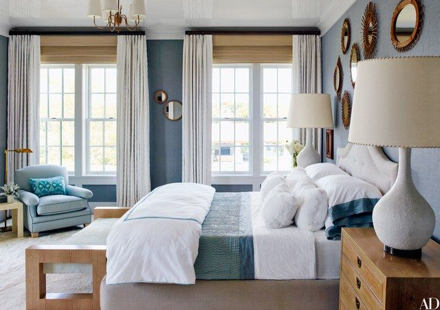 Overscale 1960s table lamps flank a Steven Gambrel–designed bed dressed with Pottery Barn sheets in a guest room | archdigest.com