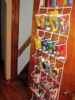 Over the door shoe organizer use to store items in bathroom, bedroom, etc, store cleaning supplies, makeup, craft supplies.
