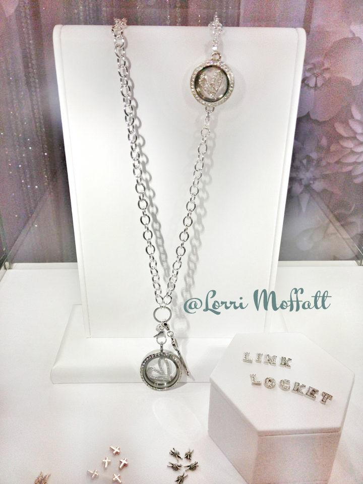 the link locket will have a special locket that stays resting right over your heart. origami owl is SO innovative