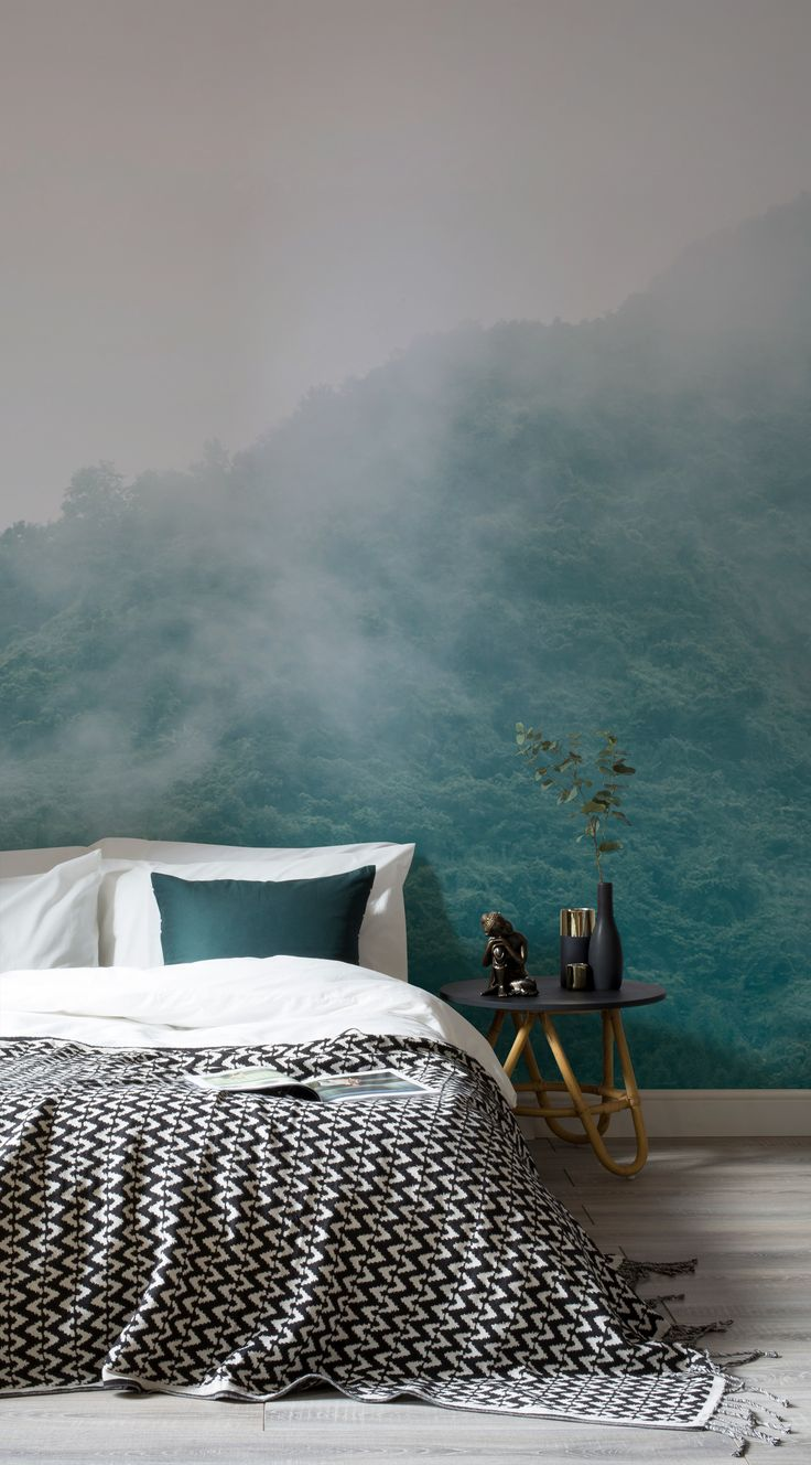 Gaze across the tree tops with this beautiful forest wallpaper mural. Clouds of mist give this mural a soft appearance, making it perfect for relaxing bedroom settings.