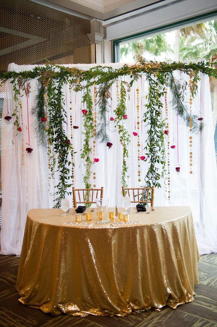 Heather & Jonah | Wedding in Tampa Bay | Garland backdrop for the ceremony. #andrealaynefloraldesign #tampaweddings