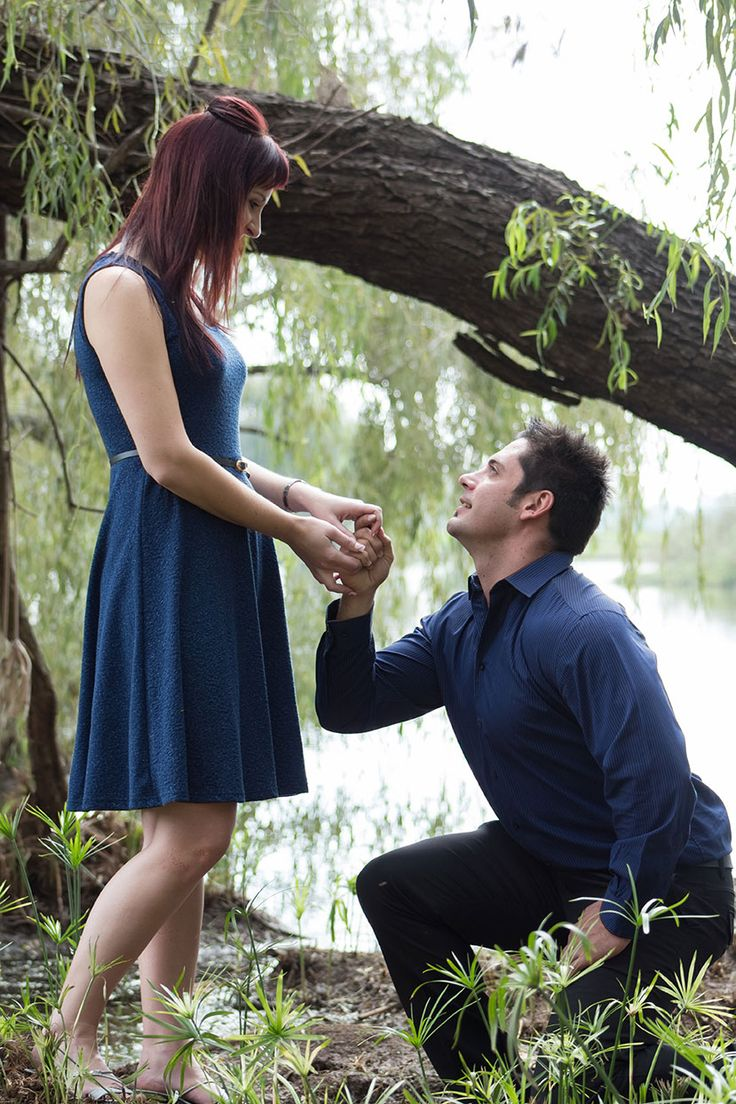 An awesome photo of Franco pretend proposing to his fiancee Adelle - A great engagement shoot idea (I don't care how cheesy is seems, I love it!). ©CarissaGagashiPhotography