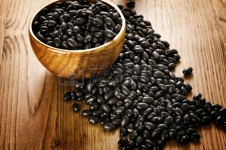 Frijoles, mexican black beans, on wooden background, biologic culture Stock Photo - 18422985
