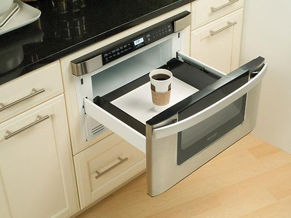 Hide your #microwave and still have it accessible with a microwaves open that opens like a #drawer. Just install this drawer below your #kitchen #countertop for an efficient use of space and a design-friendly layout. Oven opens automatically with pull/push of towel-bar handle or press of a button. Warm up your coffee and watch the chef in action.