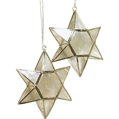 Gorgeous capiz star ornament from Ten Thousand Villages (@Tenille Blackett Thousand Villages) - made from capiz shells from women in the Philippines, hand-shaped and painted, then soldered with wire.