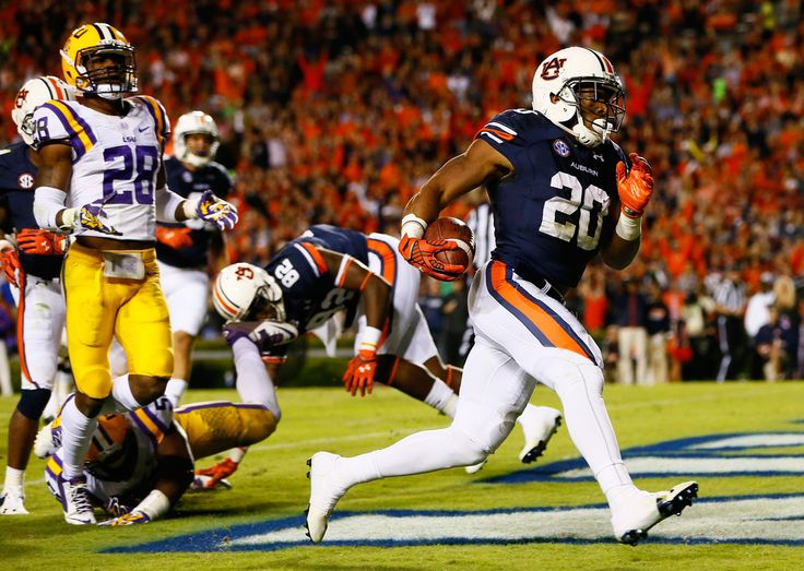 Corey Grant #20 of the Auburn Tigers scores a touchdown against Jalen Mills #28 of the LSU Tigers at Jordan Hare Stadium on October 4, 2014 in Auburn, Alabama.