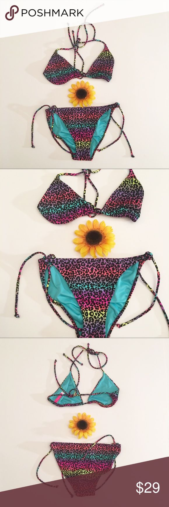 Rainbow leopard print Victoria's Secret bikini, M Very good used condition VS bikini set in a size medium. Very pretty rainbow colored animal print. I washed the suit thoroughly before listening. Victoria's Secret Swim Bikinis