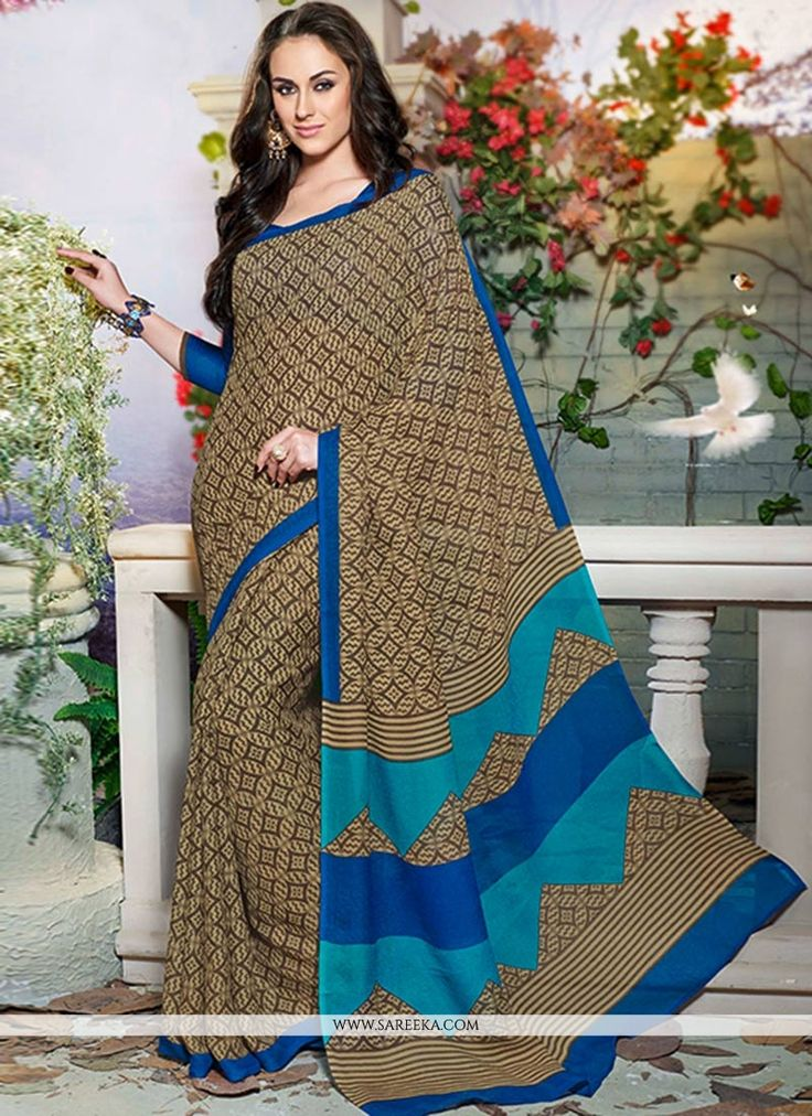 Beige printed art silk casual saree is crafted with circular geometric patterns and contrast zig zag prints catch the eye. Comes with matching blouse.(Slight color variation is possible.)...