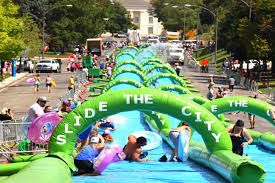 """The most popular entertainment around the city in summer season is """"slide the city"""", lots of great fun and laughter. More information, welcome to visit web: http://www.inflatableslidethecity.com"""