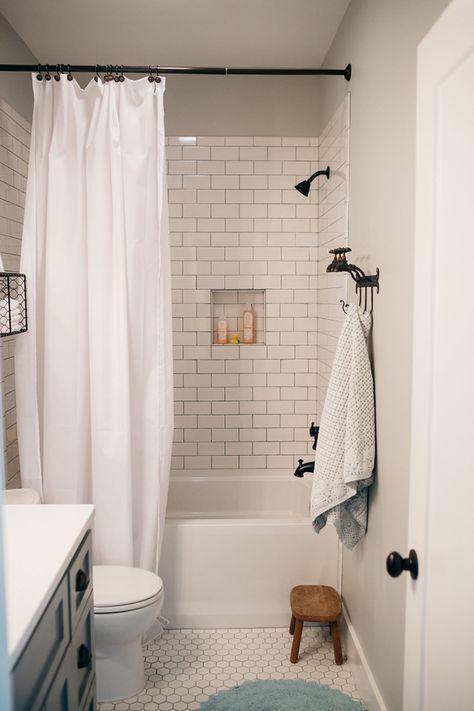 white subway tile bathroom More