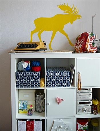 love the yellow wall sticker of a deer