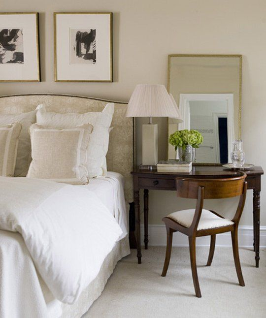 This bedroom is Charlotte York beigey minimalist, I love the desk-as-nightstand, and the mirrors balanced (as opposed to hung) to give it a less fussy feel.
