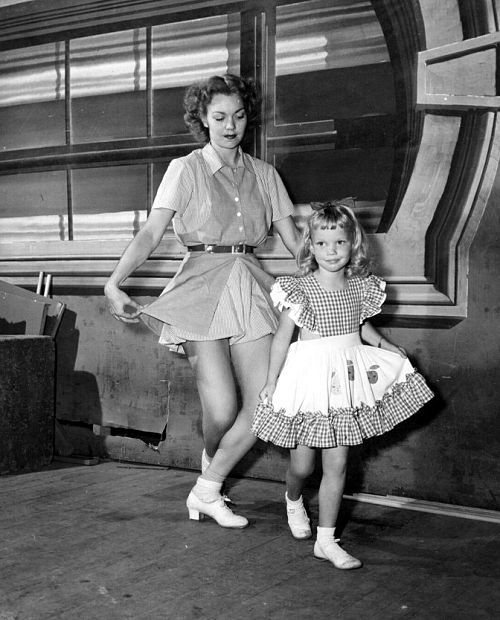 Jane Wyman essays some dance steps with daughter Maureen on the set of Night and Day