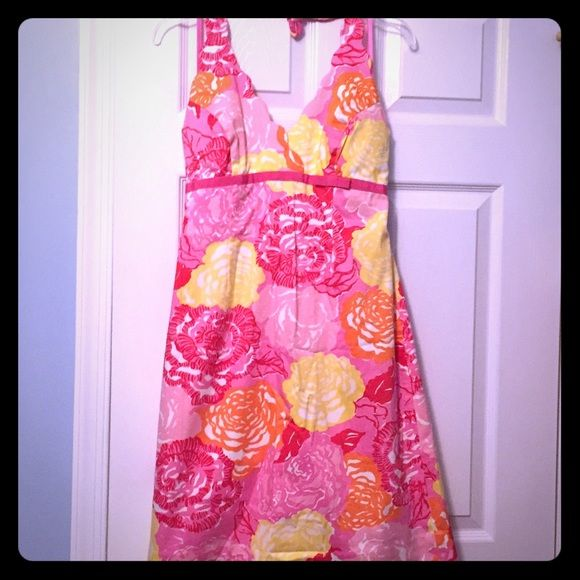 Lilly Pulitzer Floral halter Sundress NWOT Vibrant floral sundress, size 6, halter style with padding, its white tag Lilly Pulitzer, never worn, Winners circle print Lilly Pulitzer Dresses