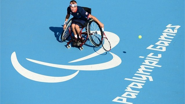 Andy Lapthorne of Great Britain in action during his Quad Doubles Wheelchair Tennis semi-final match against Mitsuteru Moroishi and Shota Kawano of Japan on Day 5 of the London 2012 Paralympic Games at Eton Manor.