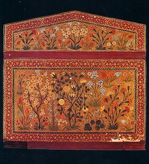 A flowe garden in cut-paper work on a mid-16th century lacquered binding. The composition includes fruit trees in blossom, roses, tulips, irises and hyacinths. Lacquered binding.